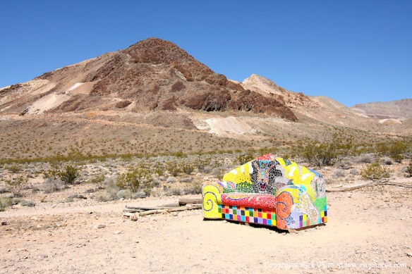 Brightly Colored Sofa and Sutherland Mountain in Rhyolite, Nevada. Photographed 03/08